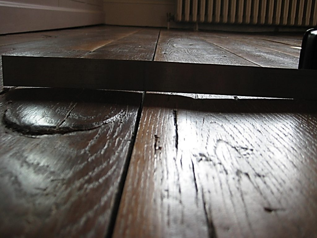 Movement in wood flooring resulting in distortion in form of crowing and cupping
